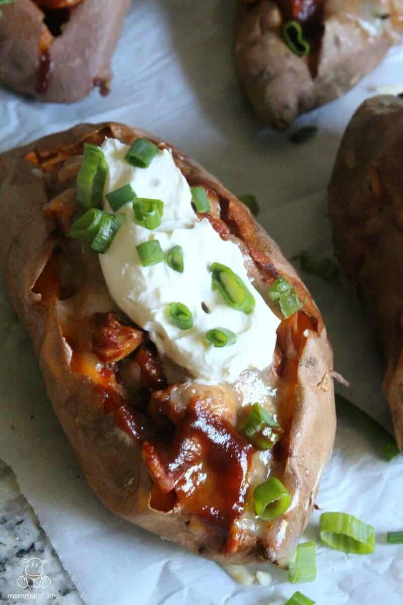 Load these Chipotle BBQ Chicken Stuffed Sweet Potatoes up with cheddar cheese, green onions, cilantro & a dollop of sour cream, or your favorite toppings. Banana peppers & minced red onions are delicious, too!